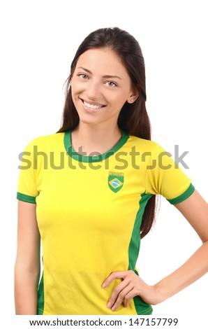 Beautiful Brazilian girl. Attractive girl with Brazilian flag on her yellow  t-shirt. Isolated on white. - stock photo