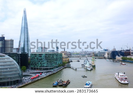 Beautiful breath-taking panoramic scenic view on London's cityscape from the Tower Bridge Exhibition. Spectacular view of the Shard, HMS Belfast and the City from the West Walkway - stock photo