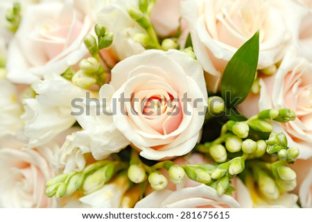beautiful bridal bouquet of roses at a wedding party  - stock photo
