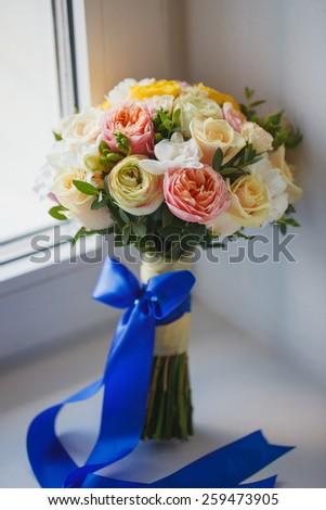 Beautiful bridal bouquet on the window - stock photo