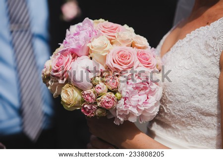 Beautiful bridal bouquet with roses and peonies - stock photo