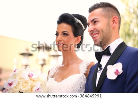 Beautiful bridal couple on wedding day smiling - stock photo