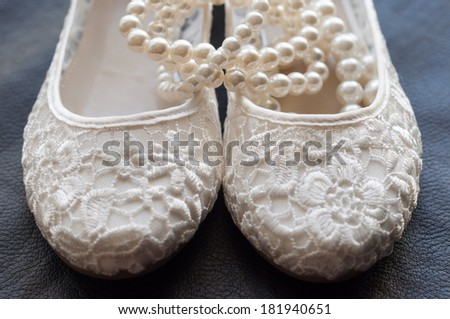 Beautiful bridal wedding shoe and beads - stock photo