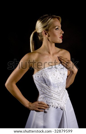 Beautiful bride against a black background - stock photo