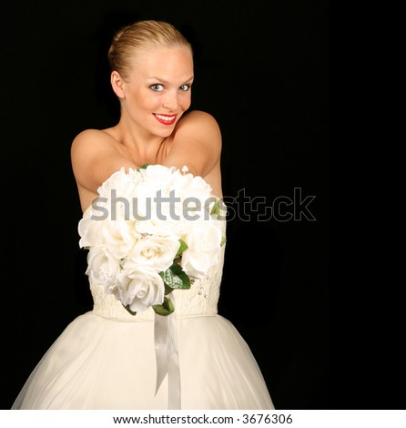 Beautiful Bride Against Dramatic Black Background - stock photo
