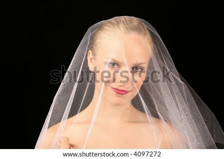 Beautiful Bride Against Dramatic Black Background - stock photo