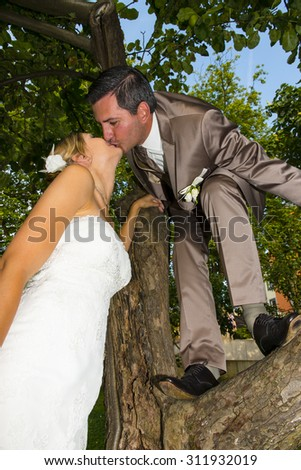 beautiful bride and groom after weddeing ceremony - stock photo