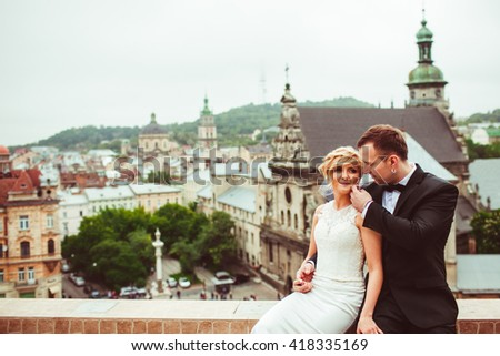 beautiful bride and groom holding hands - stock photo