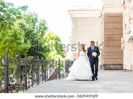 Beautiful bride and groom is enjoying wedding - stock photo