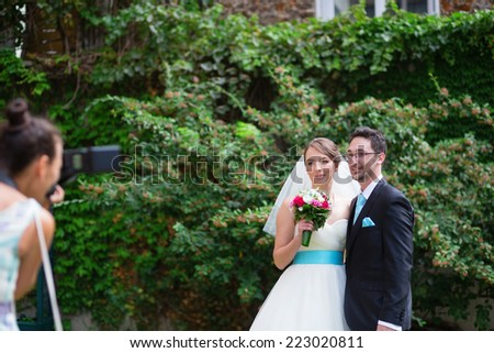 Beautiful bride and groom posing to photogtrapher on their wedding
