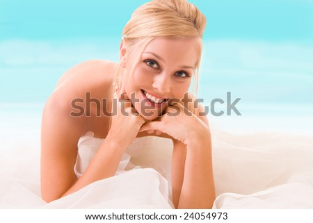 beautiful bride at the beach - stock photo