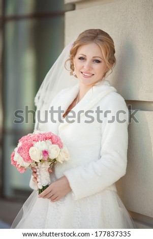 Beautiful bride at wedding day outdoors, happy newlywed woman in love waiting for groom. Lifestyle. wedding day moments. series.