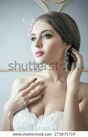 Beautiful Bride Blond Woman In White Wedding Dress. Glamour Hairstyle And Makeup - stock photo