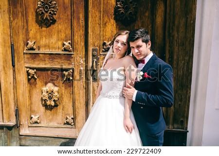beautiful bride bridegroom door - stock photo