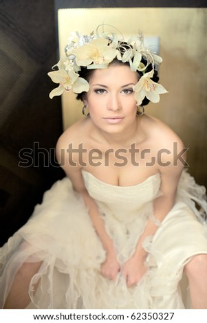 Beautiful bride  brunette with flowers in hairs  in a sexual pose - stock photo