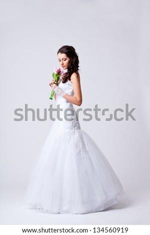 beautiful bride holding bouquet studio full length portrait - stock photo