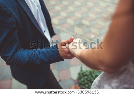 Beautiful bride holding hands