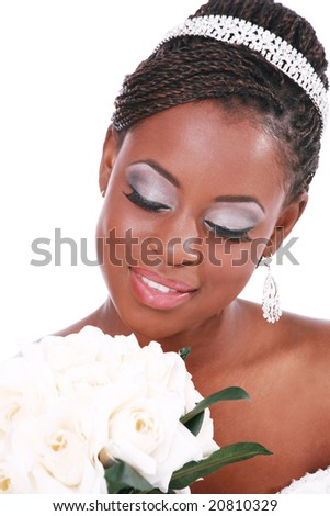 Beautiful Bride Holding Rose Bouquet with Eyes Closed