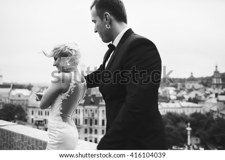 beautiful bride holds the hand of her husband - stock photo