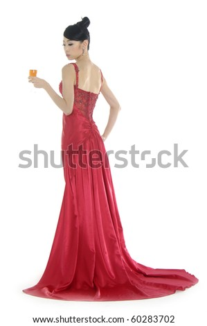 beautiful bride in beauty red dress holding wine glass - stock photo
