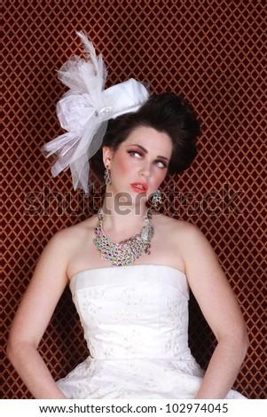 Beautiful Bride in Dramatic Wedding Fashion - stock photo