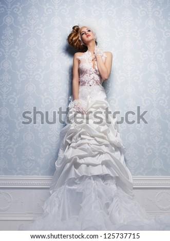 Beautiful bride in elegant white wedding dress - stock photo