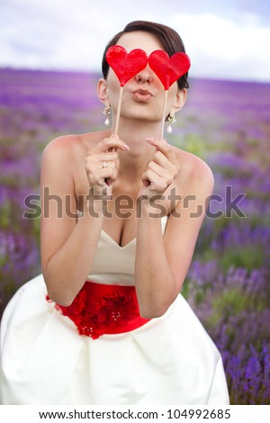 Beautiful bride in lavender meadow - stock photo