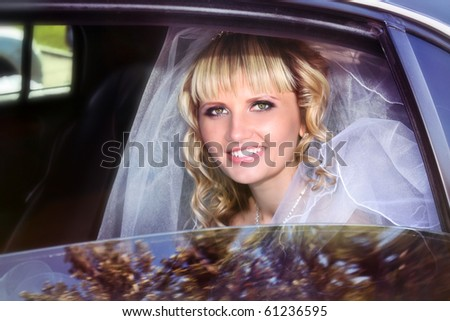 Beautiful bride in limousine - stock photo
