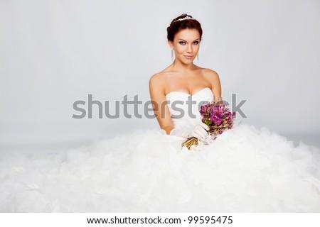 Beautiful bride in studio on white - stock photo