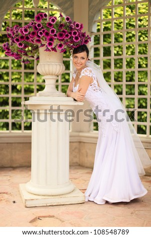 beautiful bride in the summerhouse - stock photo