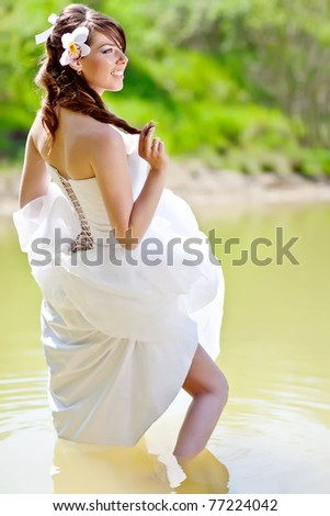 Beautiful Bride in the water - stock photo