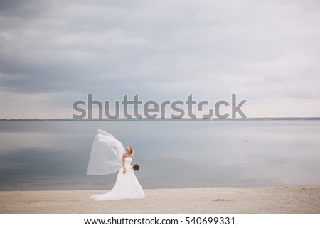 Beautiful bride in wedding day on the coast.