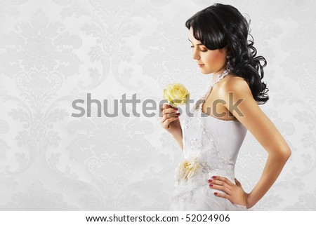 Beautiful bride in wedding dress on refined white background. Space for text. - stock photo