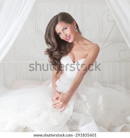 beautiful bride in wedding dress, studio - stock photo
