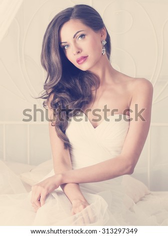 beautiful bride in wedding dress, studio. Image with retro toning