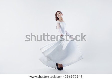 Beautiful bride in wedding dress, white background - stock photo