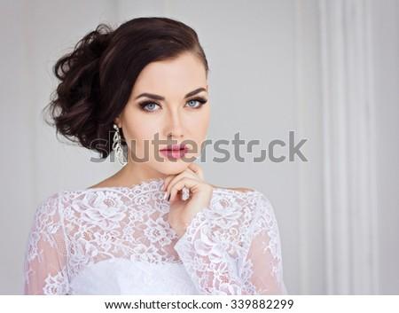 Beautiful bride in white dress - stock photo