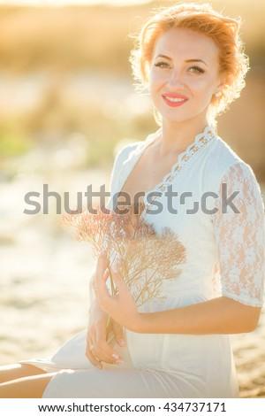 stock photo beautiful bride in white dress in the garden 434737171