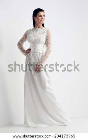 Beautiful bride in white wedding dress on white background