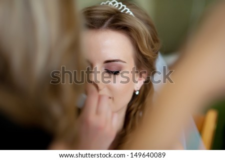 beautiful bride  in white wedding dress with hairstyle and bright makeup. Happy sexy girl waiting for groom. Romantic lady in bridal dress  have final preparation for wedding  - stock photo