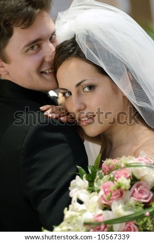 Beautiful bride in white with handsome groom on wedding day - stock photo