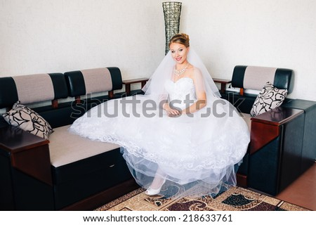 Beautiful bride is getting ready in the morning. adorable bride is getting ready in the morning. Portrait of beautiful woman in white dress