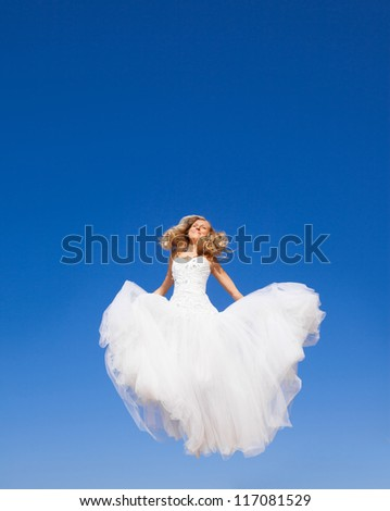 Beautiful bride jumping to the sky