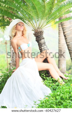 Beautiful bride like a mermaid at summer time - stock photo