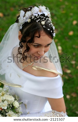 Beautiful bride looking down - stock photo