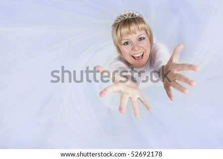 Beautiful bride  looking up at camera. - stock photo
