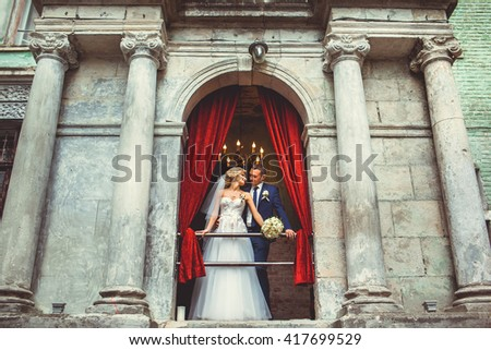Beautiful bride near the old house - stock photo