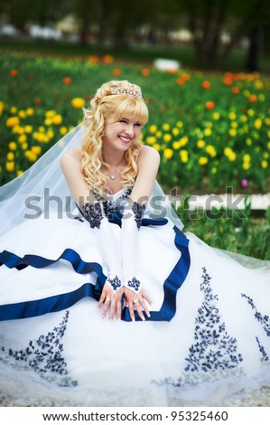 Beautiful bride on wedding walk - stock photo