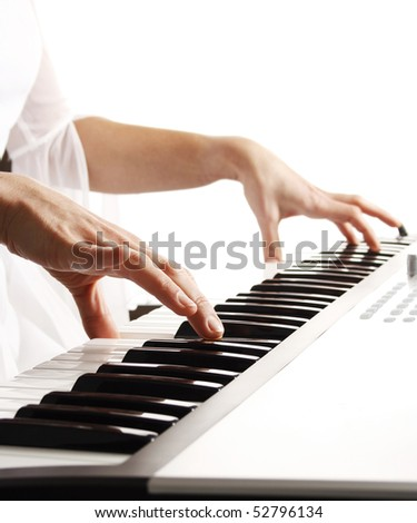 Beautiful bride playing piano - stock photo