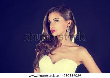 beautiful bride,  portrait on a dark background - stock photo